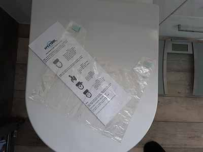 hystool stool sample collection bag on toilet seat